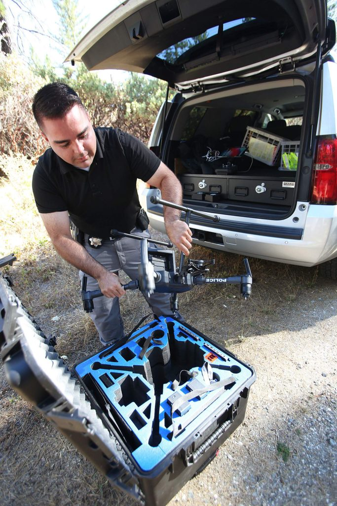 Grass Valley Police Detective Mel Bird readies to fly the department's new police drone equipped with an infrared camera as well as regular camera.