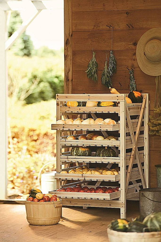 Wooden orchard racks maximize storage space, while allowing air to reach each layer of produce.