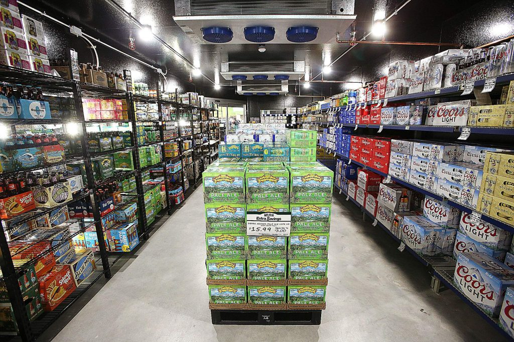 """The """"beer cave"""" at the new Higgins Corner Holiday Market has been the talk of the shop during opening day Friday."""
