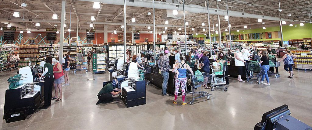 Shoppers check out from the new Holiday Market, now open at Highway 49 and Woodridge Drive in South County.