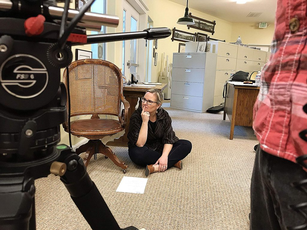 Co-producer Julia Stidham watches the filming of a segment for