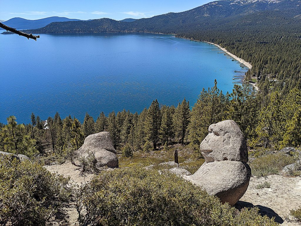 The hike to Monkey Rock leads to a nice view of Lake Tahoe and surrounding snow capped peaks of the Sierra Nevada Mountains.