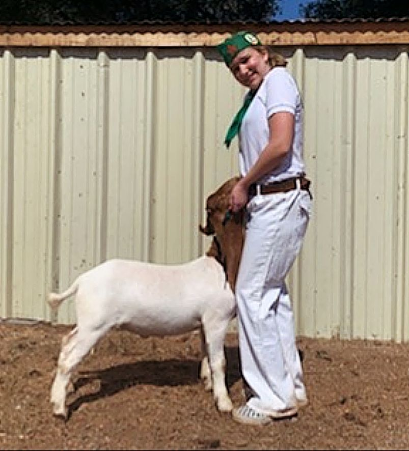 Fourteen-year-old auction participant Clara Heer, a member of Clear Creek 4-H, and her goat, Brownie.