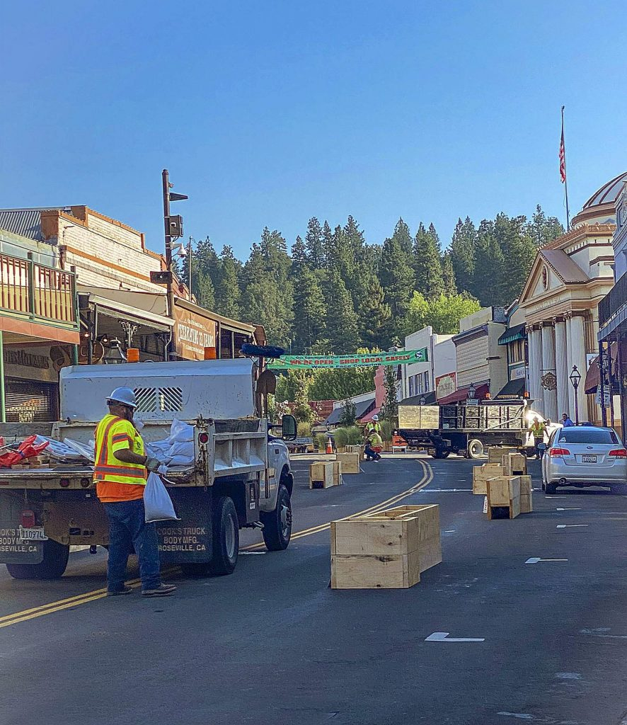 The extension of outdoor dining area down Mill Street started Monday.