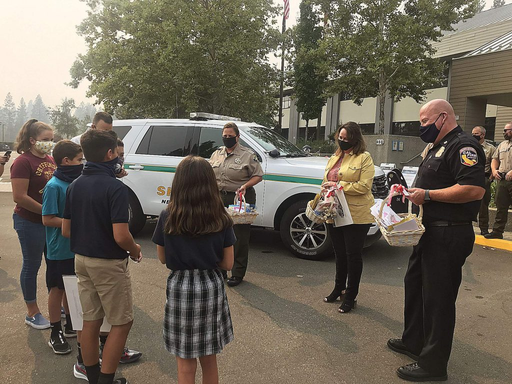 A group of students from Mt. St. Mary's Academy gathered at the Eric Rood Administrative Center Monday afternoon to express their thanks to Sheriff Shannan Moon, Nevada County Executive Officer Alison Lehman, and Cal Fire Unit Chief Brian Estes for keeping the county safe and informed during the Jones Fire.