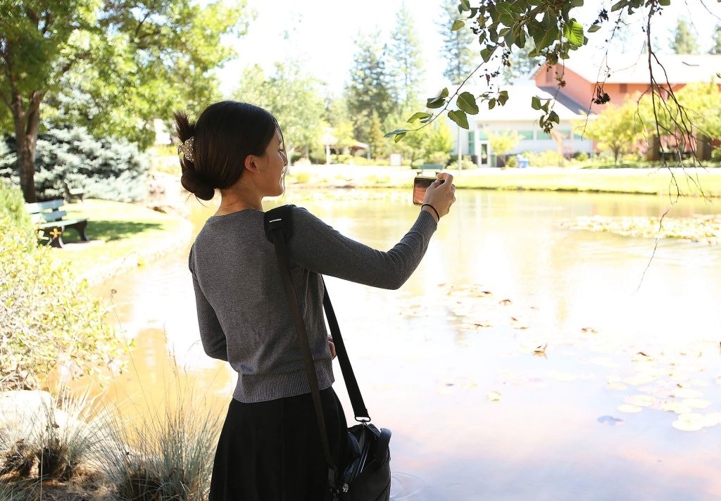 Maggie Aguilar-Diaz takes a photo of the Sierra College Campus that she misses.
