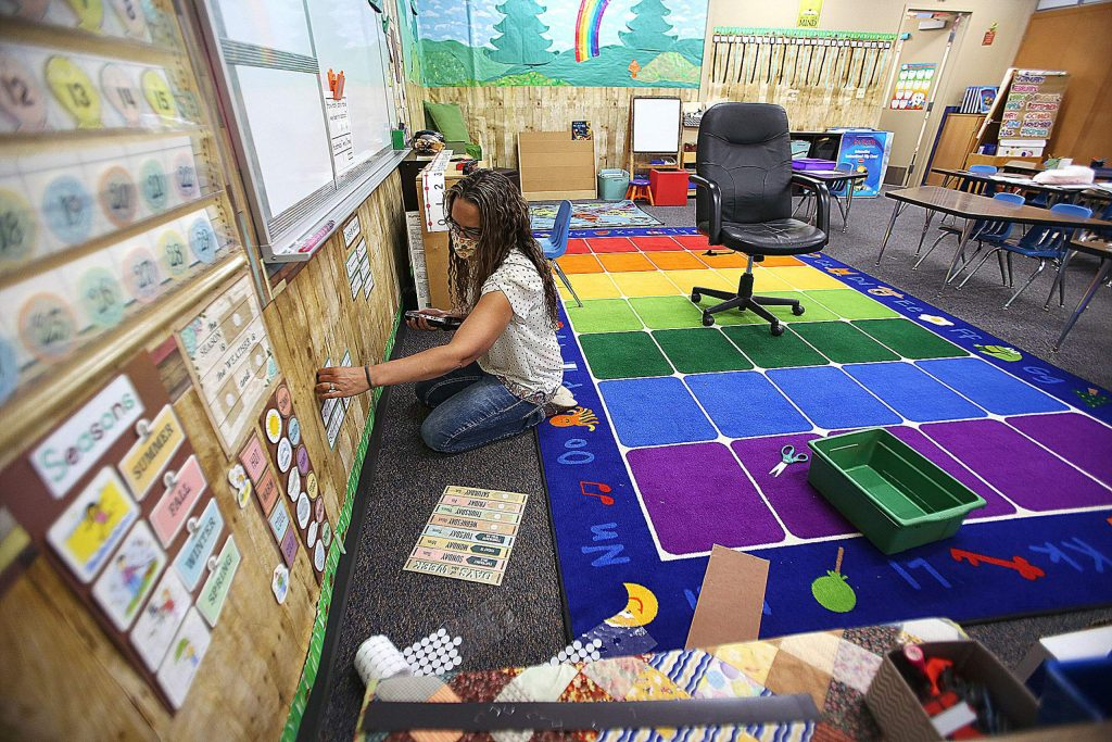 Deer Creek Elementary kindergarten teacher Vanessa Lackey on Thursday prepares her classroom for the first day of classes in Nevada City. The school is offering in-class and distance education options. About 30% of the students are taking part solely in distance learning from Deer Creek Elementary.