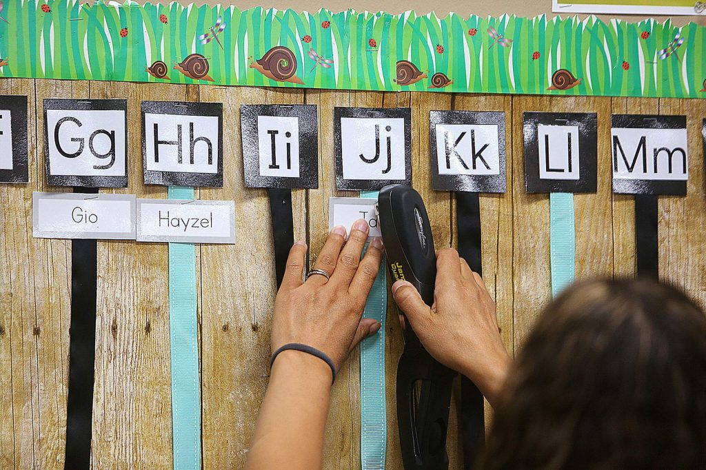 Deer Creek Elementary School teacher Vanessa Lackey preps her classroom for the first day of school with in-class students in Nevada City.