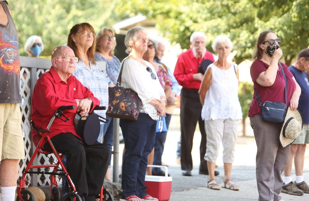 Former Grass Valley firefighters, community members, and family of former Chief John Straka gathered along Race Street during the traditional bell ringing ceremony.