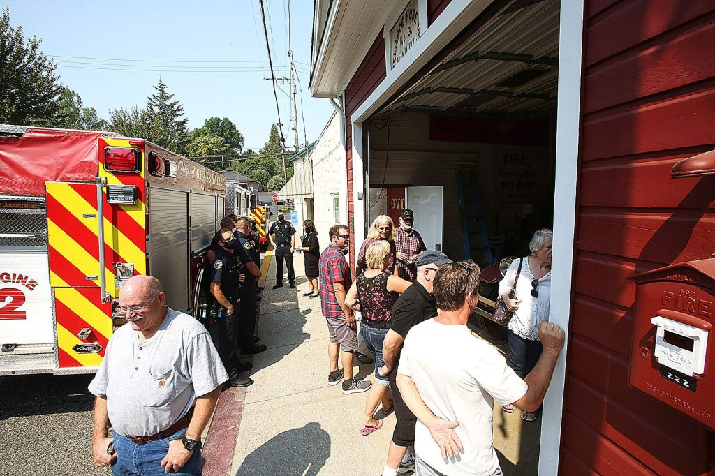 Community members gather outside of Reliance Hose Co. No. 3 off  Race Street following the traditional bell ringing ceremony which occurred Saturday at 11 a.m.