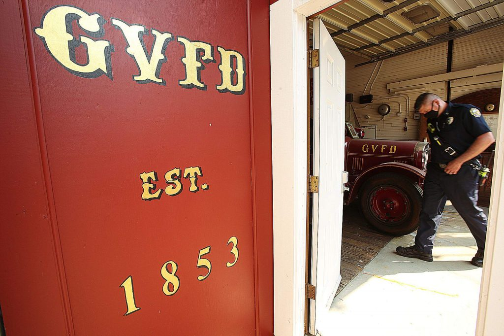 The doors of Grass Valley Fire Department's historic Race Street fire station, Reliance Hose Co. No. 3, were opened for Saturday's bell ringing ceremony to honor the passing of former GVFD Chief John Straka.