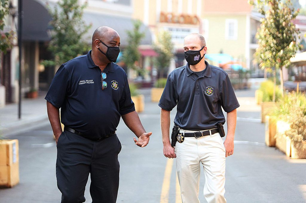 Community Relations Coordinator Jamal Walker and Grass Valley Police Chief Alex Gammelgard share a few words as they walk along Mill Street Friday morning.