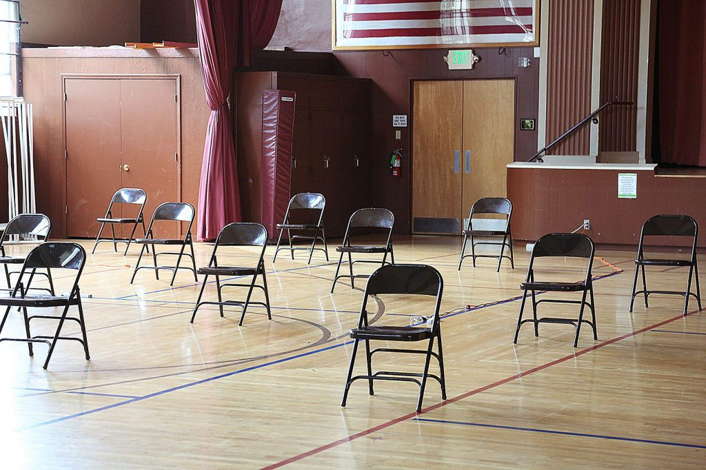 The Grass Valley Veterans Memorial Building has seating placed apart from each other to allow for social distancing guidelines. People have access to restrooms, cold water, and electrical charging outlets while at the cooling centers.