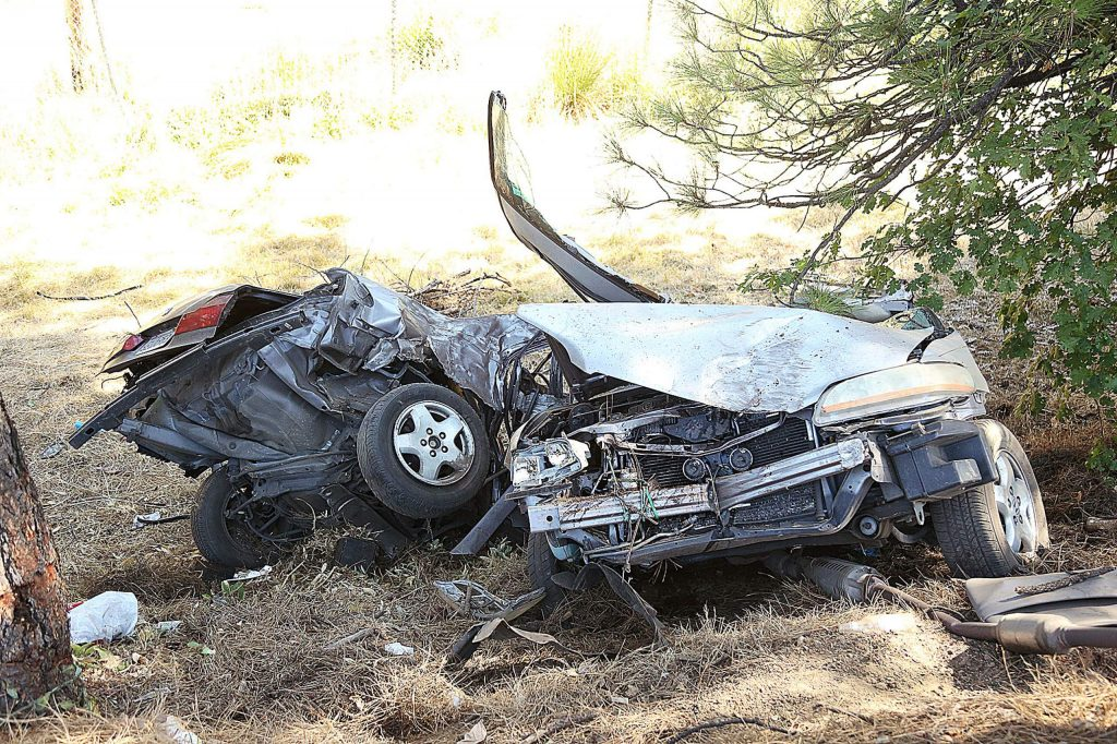 The Honda was nearly severed in half from the impact of the collision. The jaws of life were used to extract the female driver.