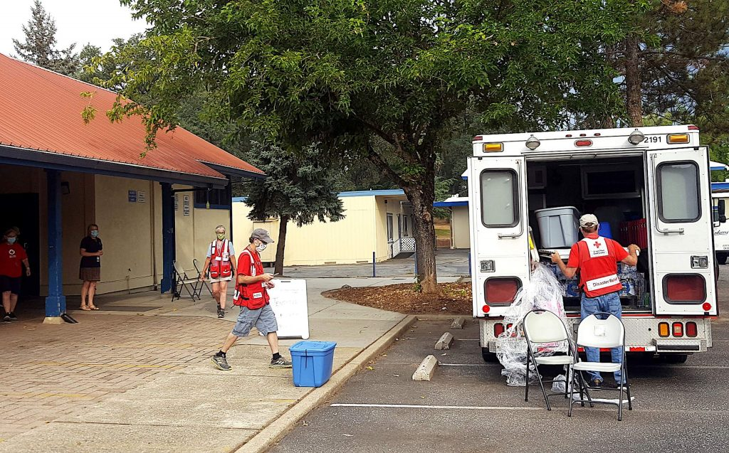 Red Cross volunteers prepare for possible evacuees from the Jones Fire Monday morning at a temporary evacuation center set up at Ready Springs Elementary School.