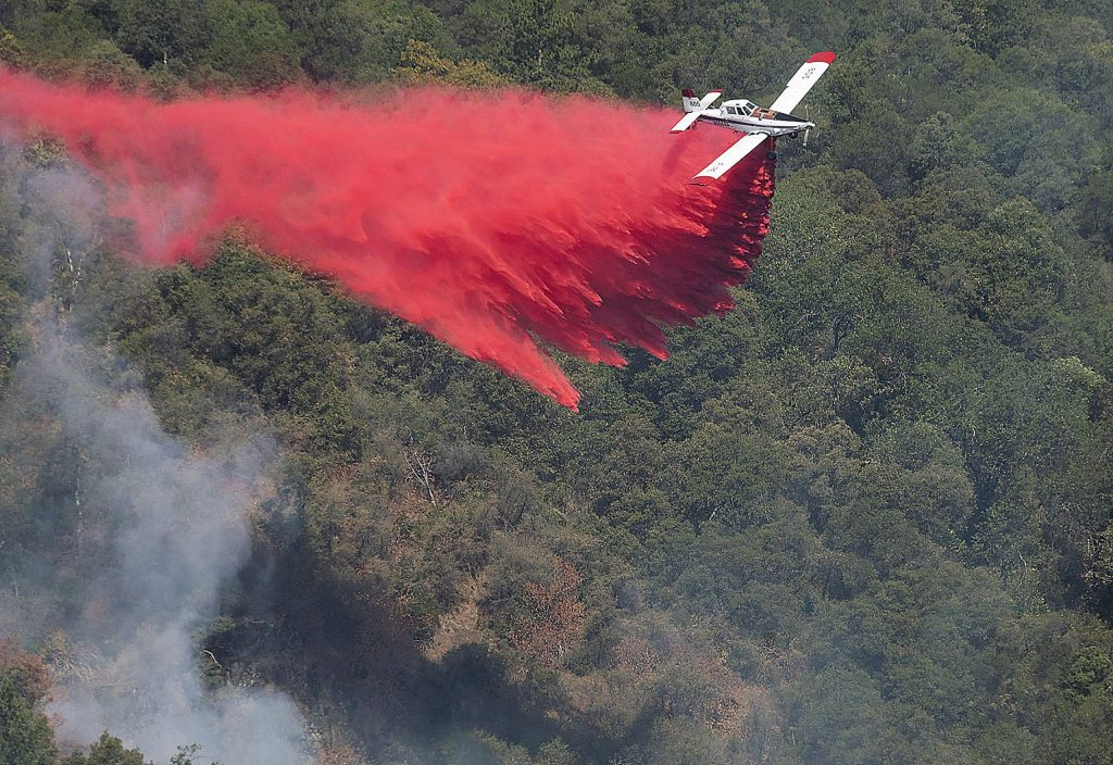 A Single Engine Air Tanker (SEAT) drops a load of retardant on the fire Monday morning. The Jones Fire led to an evacuation order for residents of Jones Bar Road, north of Woolman, and connecting roads. The area to the south — including downtown Grass Valley — was under an evacuation warning.