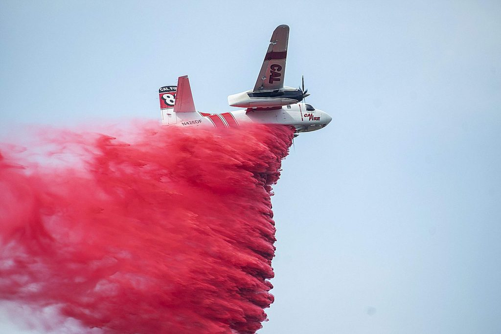 Calfire's Air Tanker drops a load of retardant on the fire Monday morning.