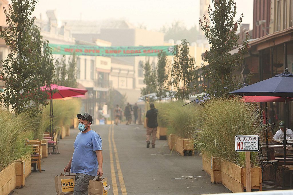Mill and Main streets in downtown Grass Valley still had their fair share of visitors despite the smoke in the air.