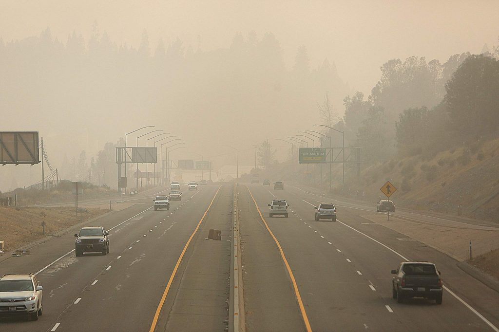 Vehicle traffic along the Golden Center Freeway can be seen driving into a shroud of smoke Saturday between Grass Valley and Nevada City.