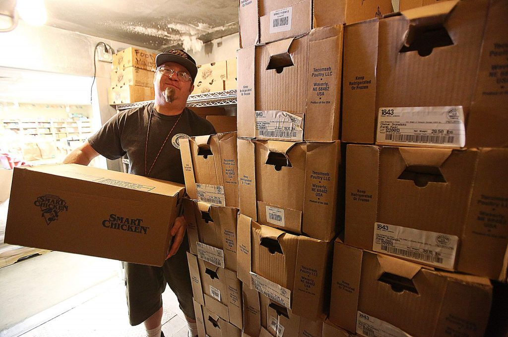 Interfaith Food Ministries Executive Director Phil Alonso holds a box of Smart Chicken being stored inside of its walk-in freezer. Nearly 3,500 pounds of Smart Chicken was donated Thursday morning, with the help of SPD Grass Valley and Nevada City customers.