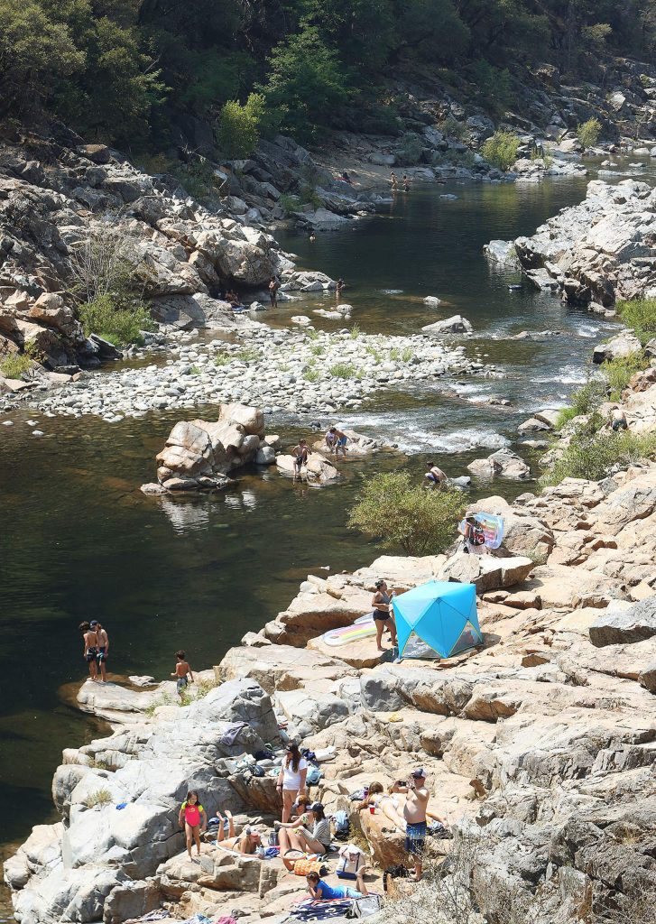 Multiple groups of people can be seen enjoying the South Yuba River at Edwards Crossing last weekend from the historic Edwards Crossing Bridge. Many more people are expected to flock to Nevavda County's waterways to seek relief from the coming heat wave this Labor Day weekend.