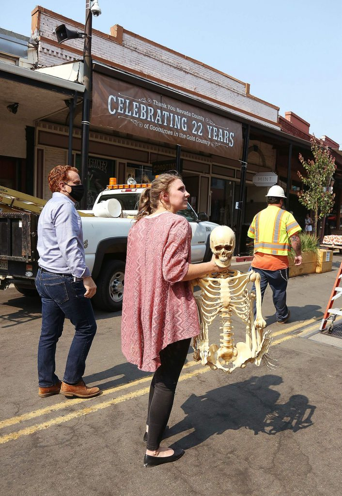 Grass Valley Community Development Analyst Taylor Day helps decorate downtown Grass Valley Wednesday afternoon.