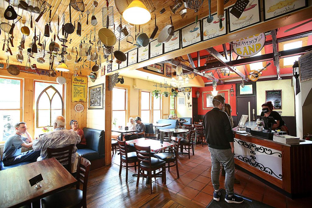 Ike's Quarter Cafe in Nevada City is open once again, with indoor seating with a limited capacity, and using a new order counter to better assist with social distancing requirements. Place markers have been put on some tables to keep people from sitting there.