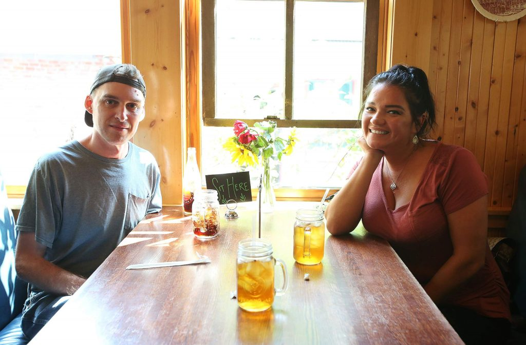 Yuba City's Evan Grant and Sandra Suarez await their meals from an indoor dining booth at Ike's Quarter Cafe last week in downtown Nevada City.