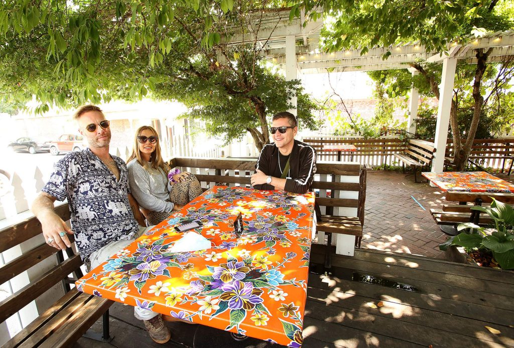 A group of friends enjoyed the outdoor dining area at Ike's Quarter Cafe in downtown Nevada City last week after the restaurant reopened.