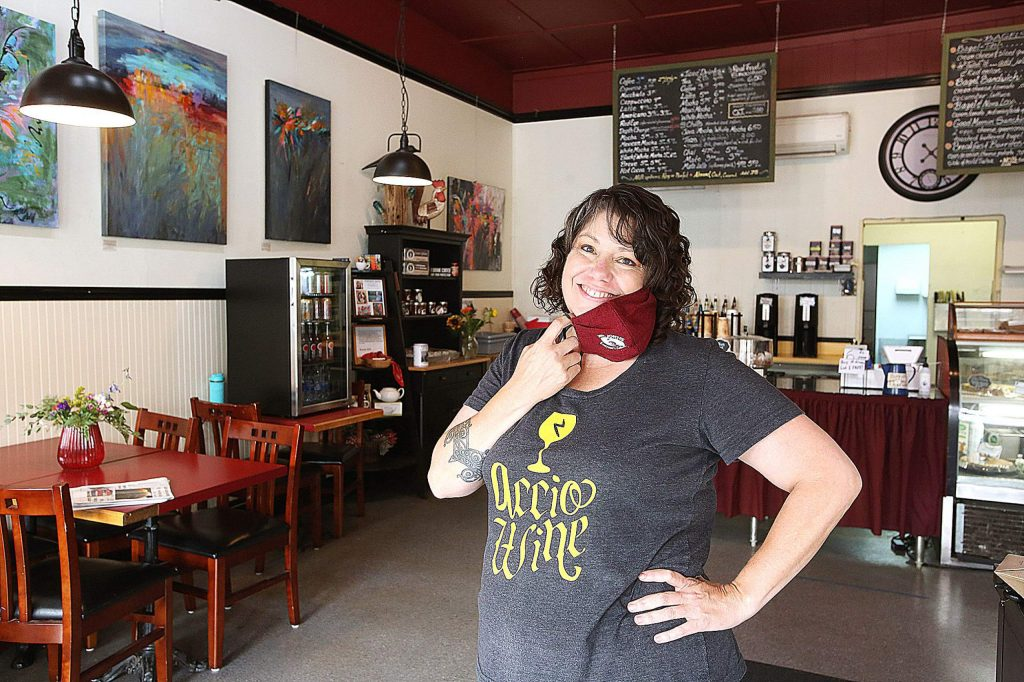 Elizabeth Raiche smiles from behind her mask as the proud new owner of Java John's in downtown Nevada City.