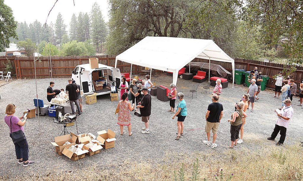 People wait in line for Frena Bakery's Kosher foods brought to Nevada County from San Francisco Thursday afternoon.