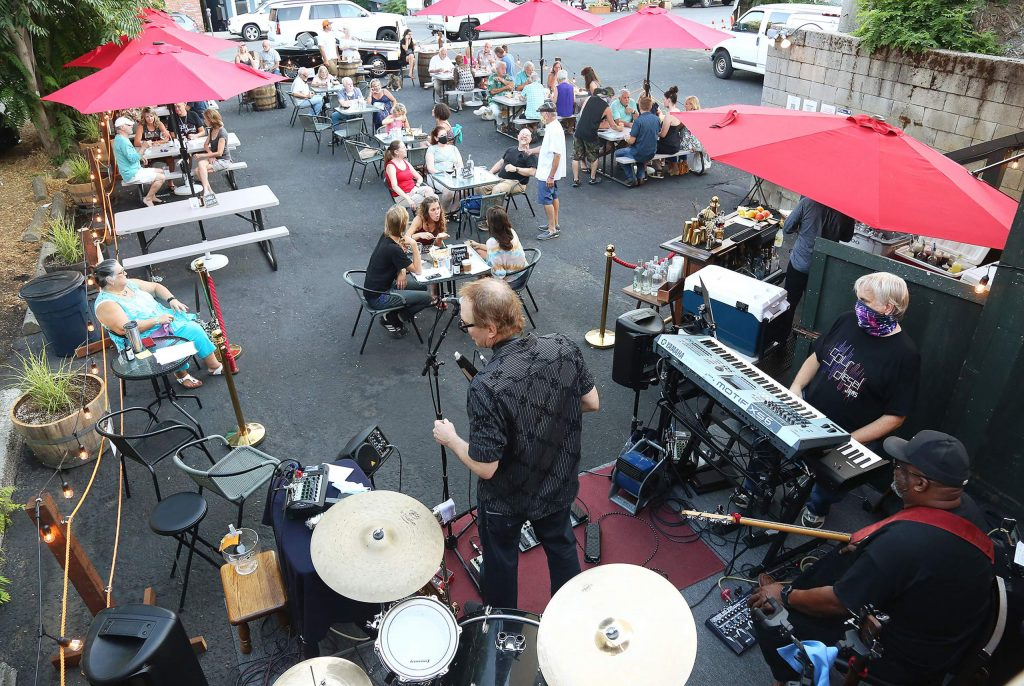 Live music from the Sacramento based group, Sour Diesel Jams, performs on the back patio stage at The Golden Era in July. Downtown Nevada City venues will continue to be able to showcase outdoor amplified music after some recent complaints.