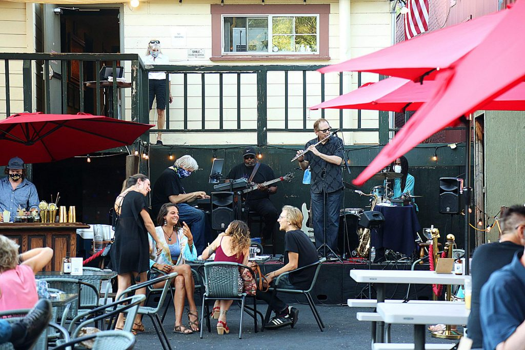 Sour Diesel Jams performs on a back patio in Nevada City. Some musicians recently feared they would no longer be able to play amplified music outdoors after one business was the subject of multiple noise complaints.
