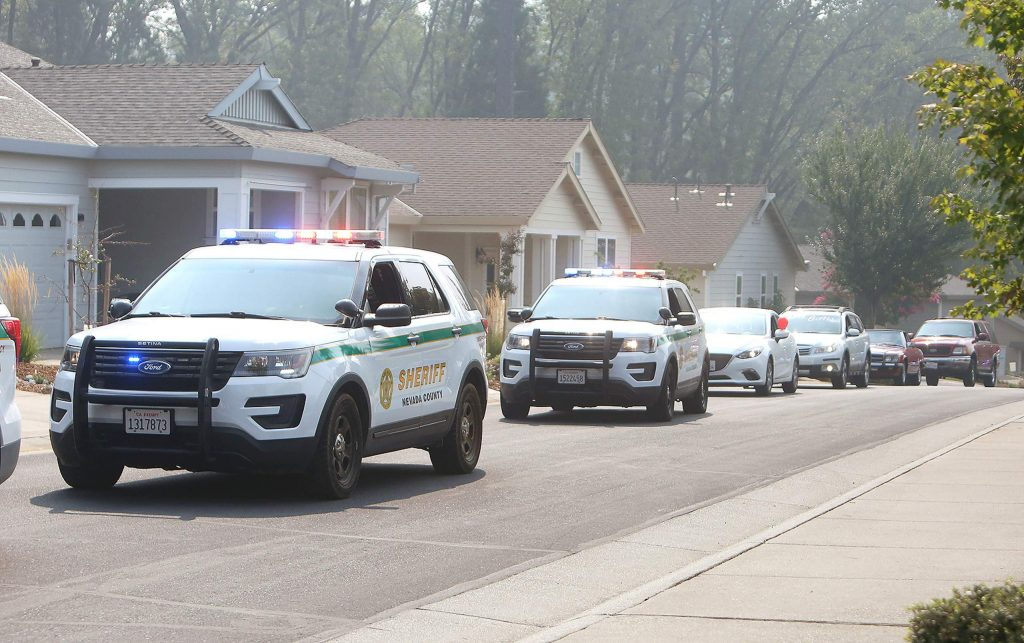 A procession of law enforcement, firefighter, and personal vehicles made their way in front of Lou Conter's Grass Valley home Saturday to surprise him for his 99th birthday.
