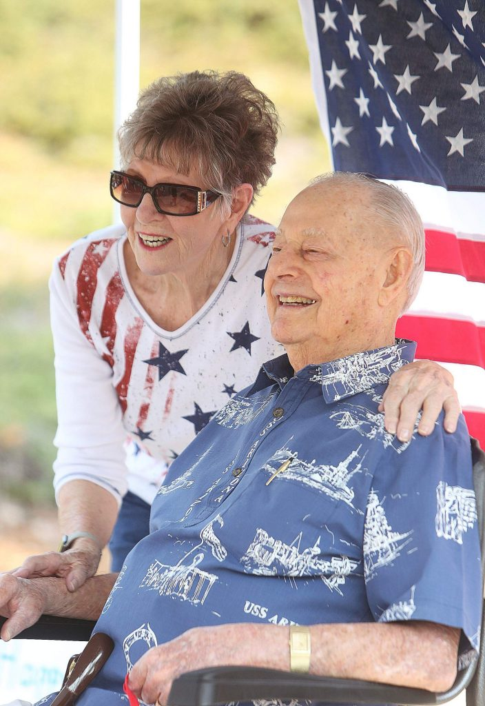 Lou Conter poses for a picture with Mary Johanson during Saturday's drive-by birthday celebration.