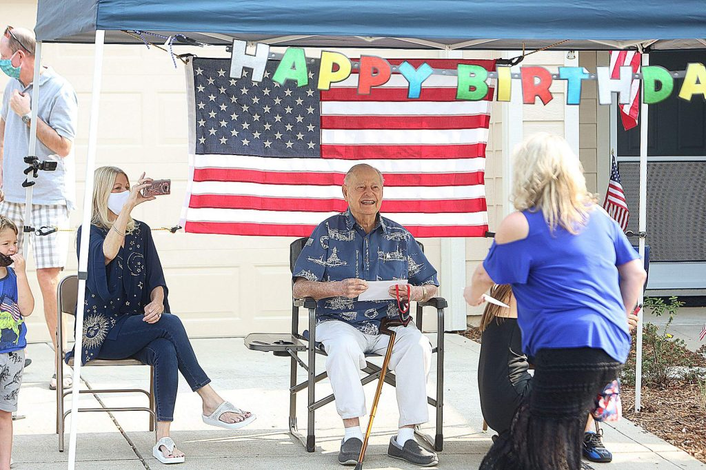 USS Arizona and Pearl Harbor survivor Lou Conter greets those that came by to wish him a happy 99th birthday Saturday morning in front of his house at Eskaton in Grass Valley.