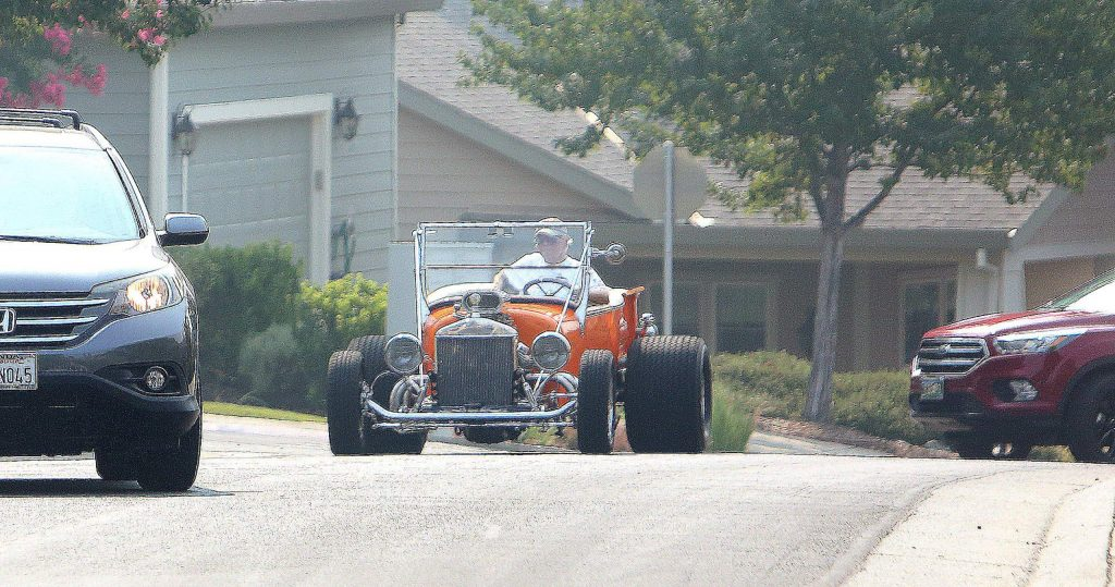 Vehicles from the Roamin Angels Car Club drove by to salute WWII Veteran Lou Conter Saturday at Eskaton in Grass Valley.