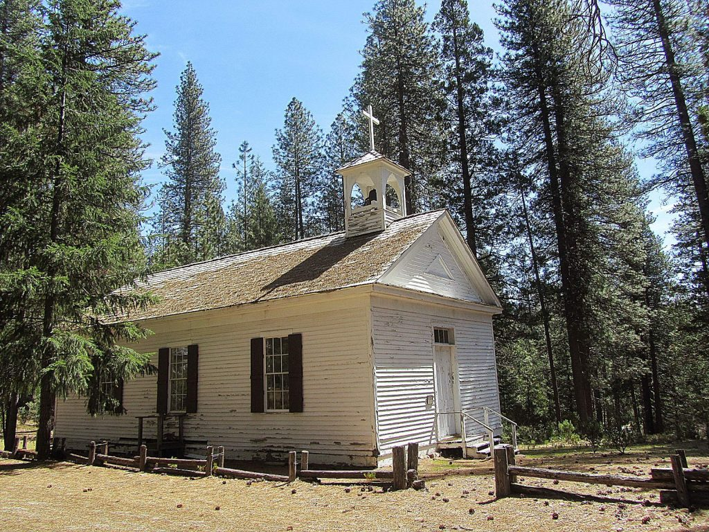 """When you enter the town, you'll see a quaint school house and a church. """"Babe"""" Pinaglia purchased the church in 1969. Slated for demolition it was moved from French Corral to North Bloomfield. Built in 1860 to train civil war soldiers, in 1910 it became a church dubbed the Birchville Catholic Church."""