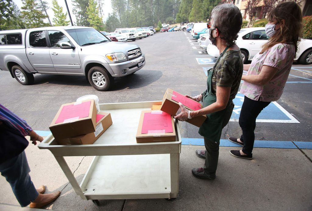 Seniors drive into the Nevada City Senior Apartments parking lot to pick up a five-day supply of emergency meals being distributed by Gold Country Senior Services. Gold Country Senior Services hopes to one day have their own senior center they can use to serve the area's seniors.