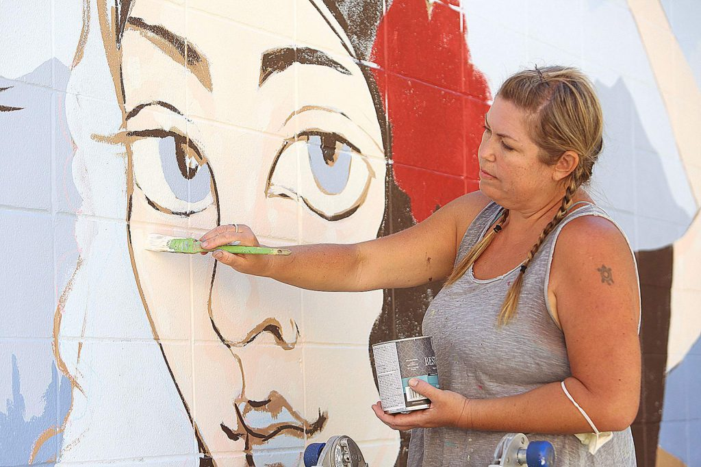 Grass Valley mural artist Ursula Young works on the details of Lola Montez's face in her new mural going up across from the Downtown Grass Valley Association offices on Neal Street. The mural has been commissioned by MEC Roofing with materials donated by Hills Flat Lumber