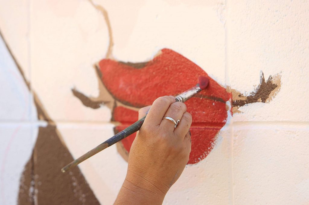 Mural artist Ursula Young adds details to the Lola Montez inspired mural going up in downtown Grass Valley.