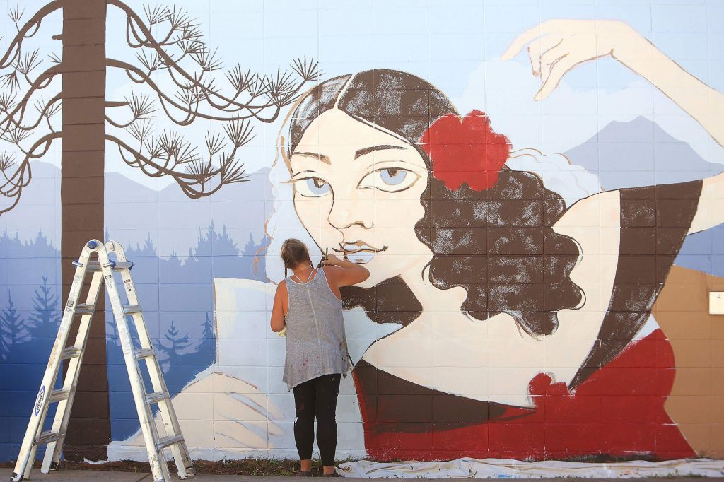 Downtown Grass Valley's latest mural is taking shape alongside Sourdough and Co. at 121 Neal St. Artist Ursula Young said that her mural depicting Lola Montez and a Sierra-scape with old Grass Valley buildings is slated to be completed today.