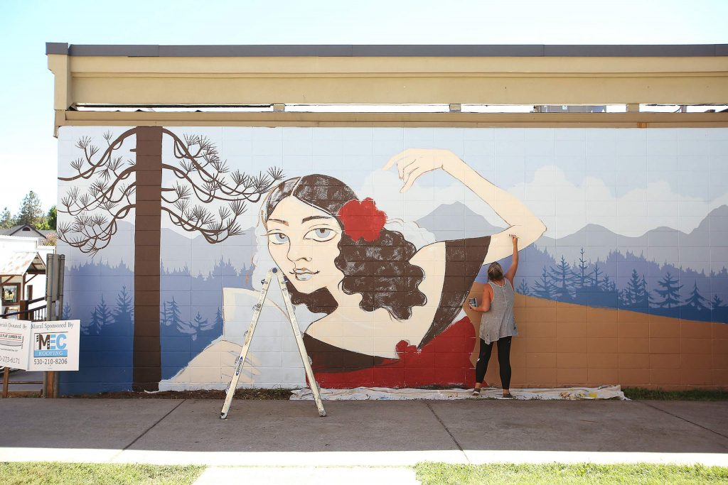 Downtown Grass Valley's latest mural is taking shape alongside Sourdough and Co. at 121 Neal St. Artist Ursula Young said that her mural depicting Lola Montez and a Sierra-scape with old Grass Valley buildings is slated to be completed later today.