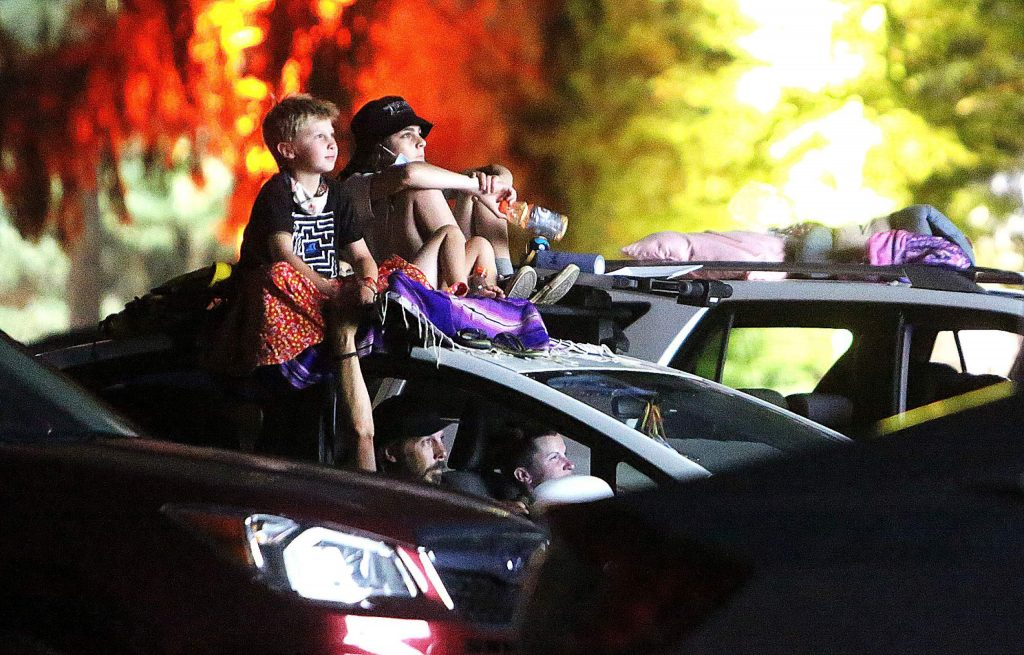 A family uses the top of their vehicle to watch from a selection of live and animated shorts selected from the Bay Area International Children's Film Festival Tuesday night at the Nevada City Film Festival.