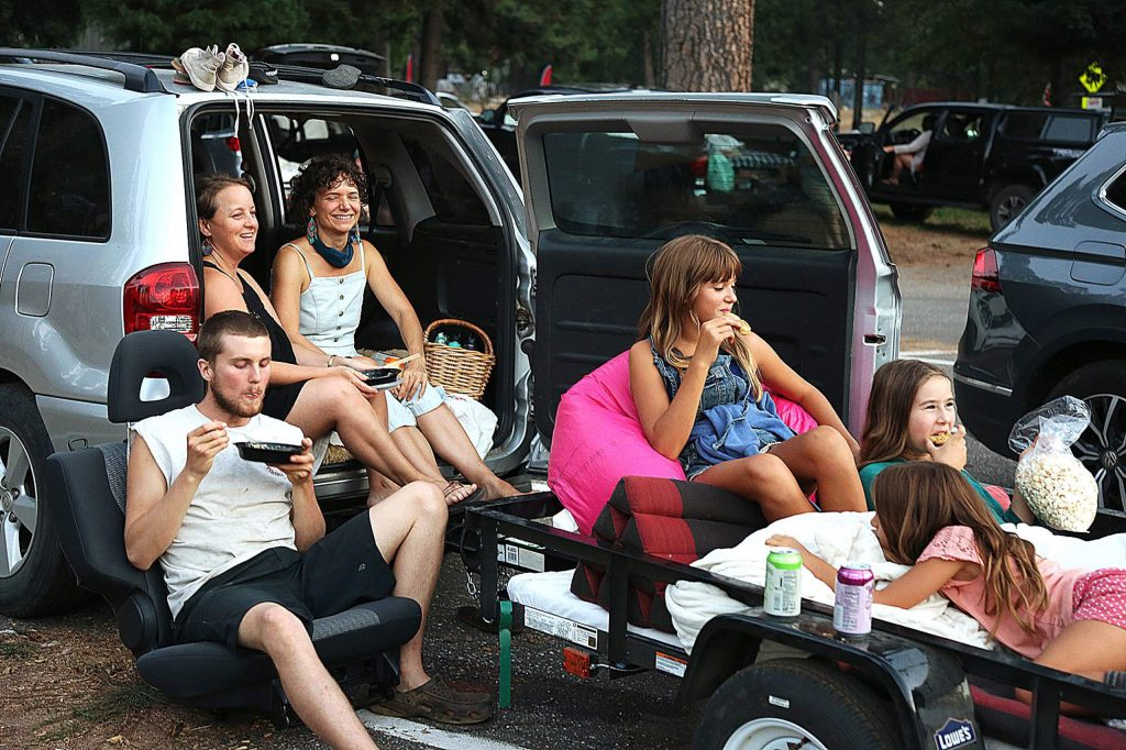 A family uses a vehicle trailer to help their outdoor viewing experience Tuesday night at the Nevada City Film Festival's drive-in at the fairgrounds.
