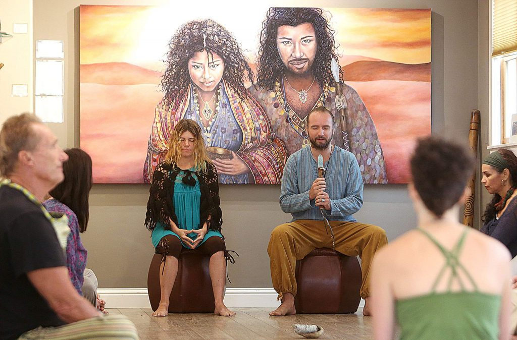 Niwan Yod, and Aeolius Alevizakis of Golden Lotus Gallery and Lounge in Nevada City lead an intentional conversation talking circle among the artistry of Yod, who has her art up on the walls of the Broad Street gallery.