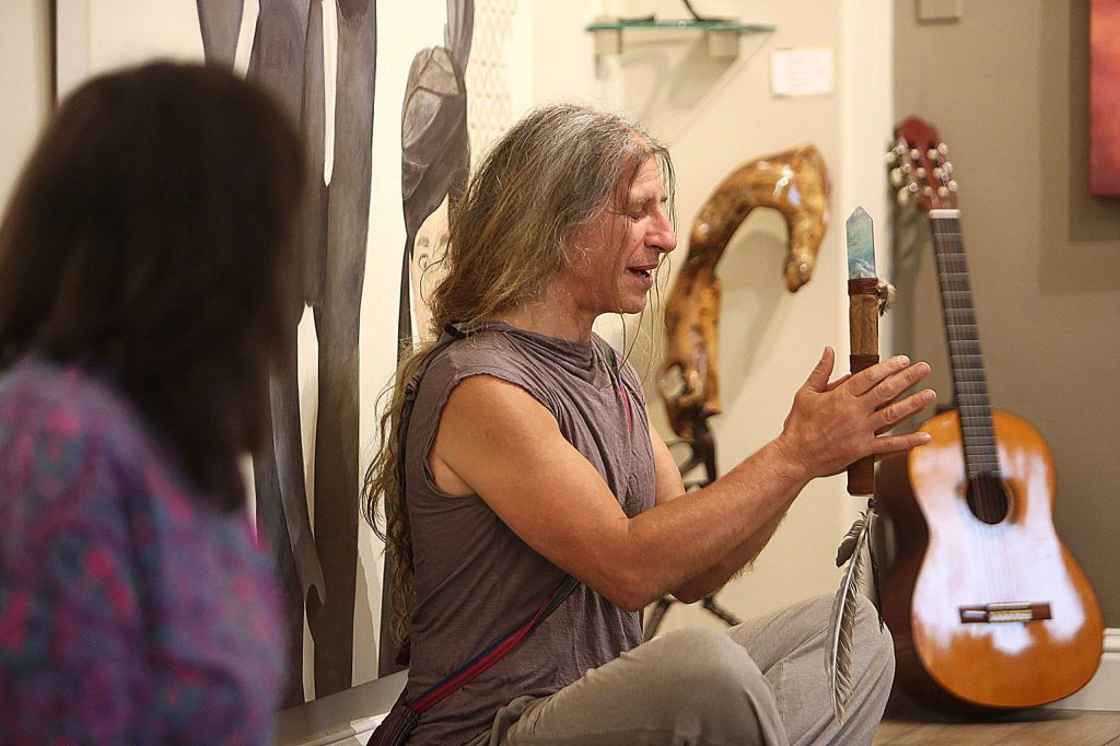 A member of the talking circle holds a crystal while he is given the opportunity to speak.