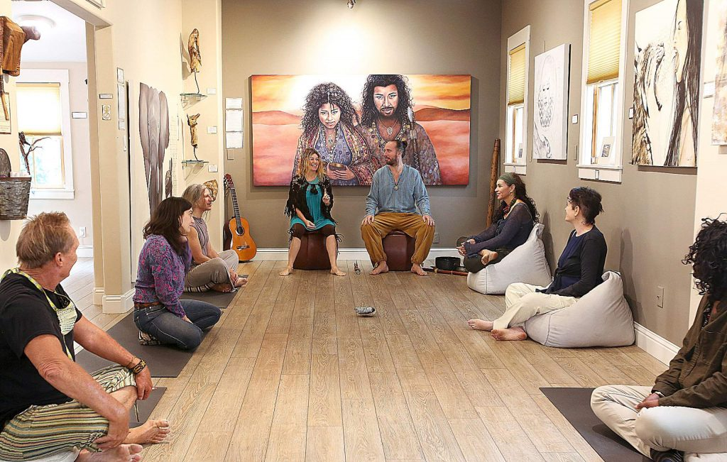 Niwan Yod and Aeolius Alevizakis of Golden Lotus Gallery and Lounge in Nevada City lead an intentional conversation talking circle among the artistry of Yod, who has her art up on the walls of the Broad Street gallery.