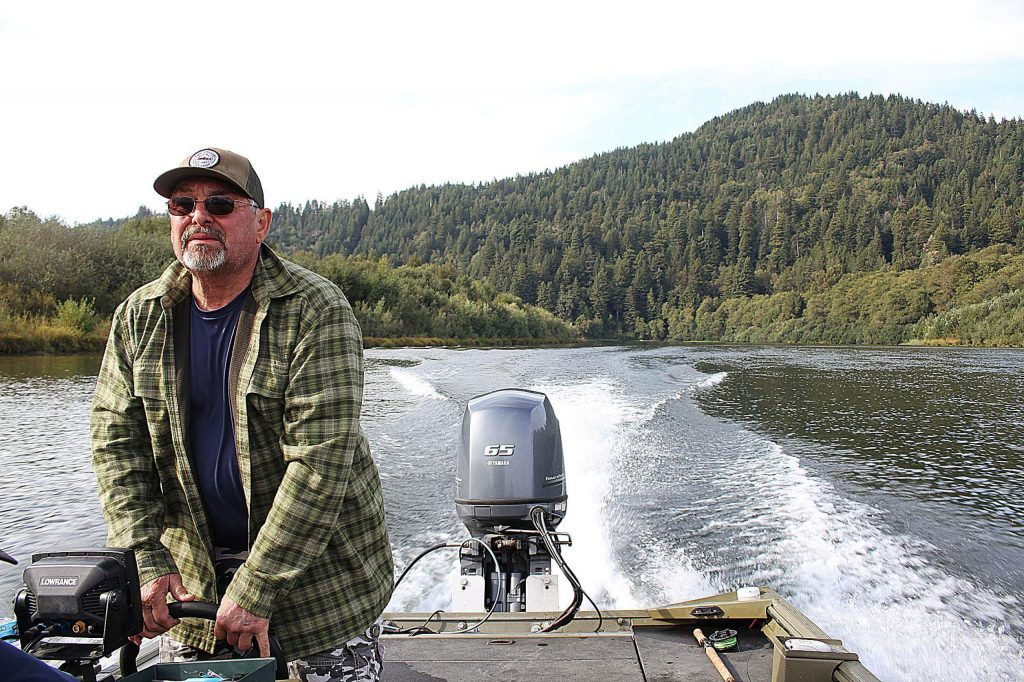 Bill McCrea driving his boat on the Klamath River. As the fall progresses the steelhead will continue to migrate upstream on the Klamath with many taking the Trinity River turn off. With the weather hopefully cooling down waders and warm clothes will become the norm.