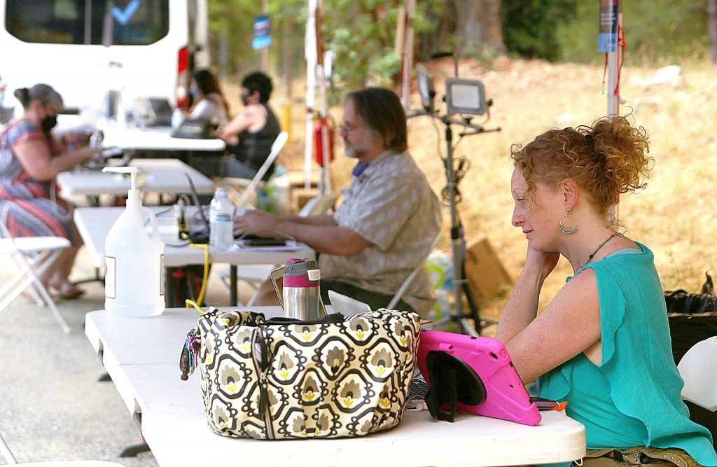 Nevada City's Jasmine Friedman utilizes the PG&E community resource center located in the parking lot of the Nevada City Elks Lodge, during Tuesday's Public Safety Power Shut-offs.